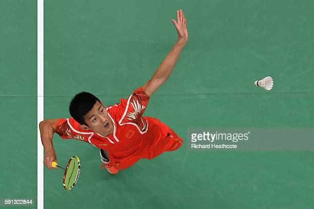 Chen Long aims to hit the incoming shuttlecock.