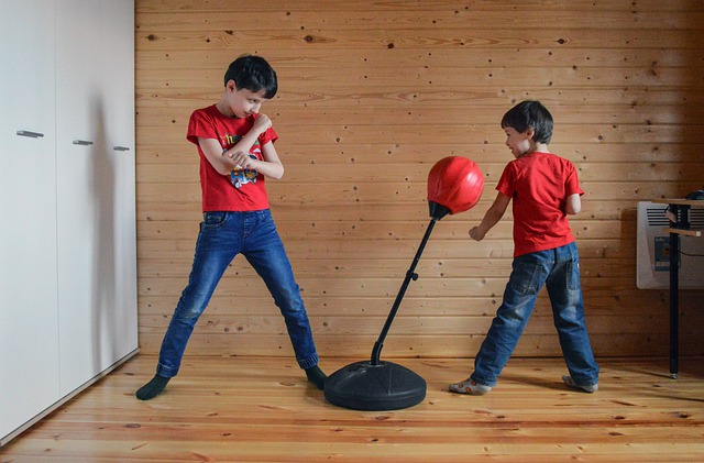 Two kids are practicing boxing.